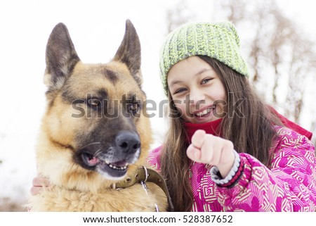 child hugging a dog, winter walk