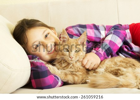 child hugging a kitten - stock photo