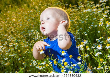 child in a meadow of daisies