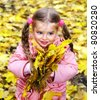 Child in autumn orange leaves. Outdoor. - stock photo