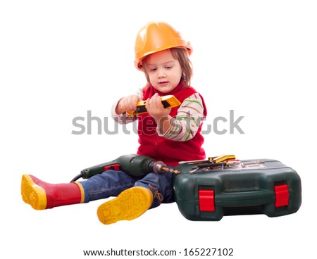Child in builder hardhat with tools. Isolated over white   - stock photo