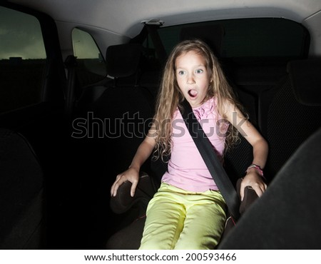 Child in car. Shocked girl. Accident - stock photo