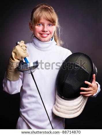 Child in fencing costume holding epee . Black background. - stock photo