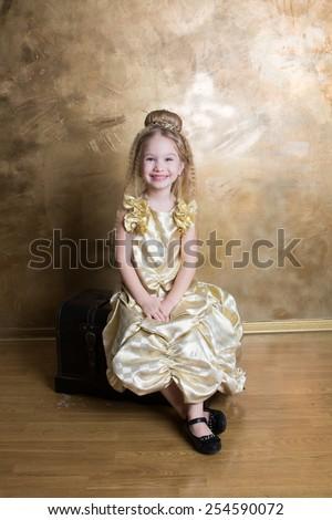 Child in golden dress - stock photo