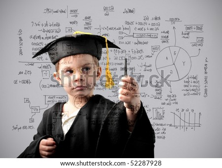 Child in graduate uniform writing some maths exercises - stock photo