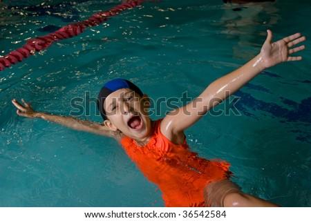 Child in swimming pool - stock photo