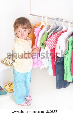 child in the clothes shop - stock photo