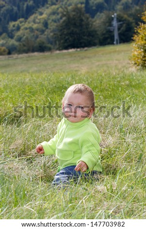 Child in the grass - stock photo