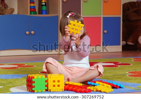 Child in the nursery builds with blocks