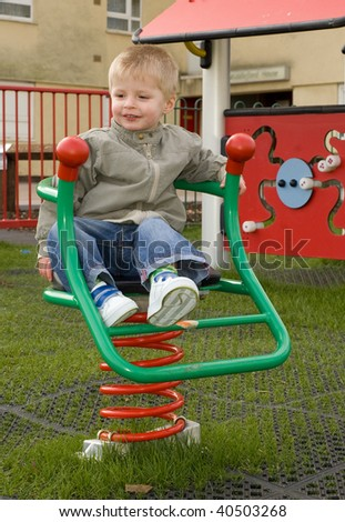 Child in the nursery  playground - stock photo