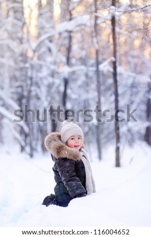 child in the winter forest, a lot of snow