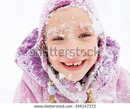 Child in winter. Happy girl on snow - stock photo