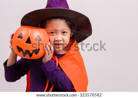 Child in Witch Costume on White / Child in Witch Costume / Child in Witch Costume, Studio Shot - stock photo