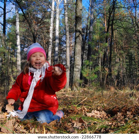 Child  in wood outdoors autumn