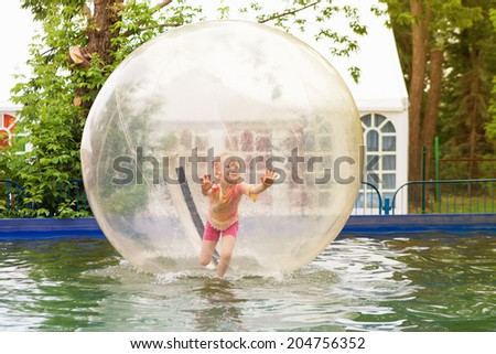child in zorb - stock photo