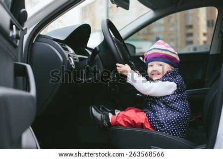 child is driving - stock photo