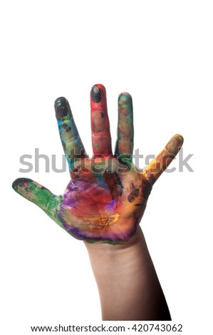 Child is holding up painted art hand on white isolated background - stock photo