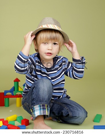 Child, kid, playing with building blocks, clothing and fashion concept - stock photo