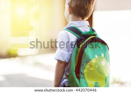Child leaving home to his first day of kindergarten - stock photo