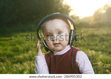 child listening to music on headphones - stock photo