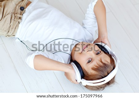Child listens to music