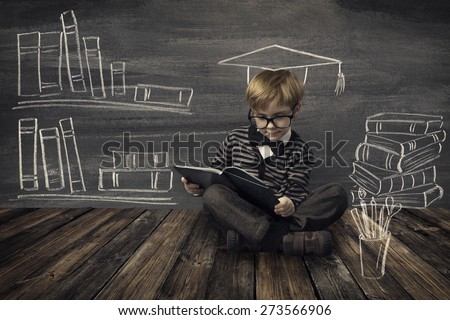 Child Little Boy in Glasses Reading Book over School Black Board with Chalk Drawing, Kids Preschool Development, Children Education Concept - stock photo
