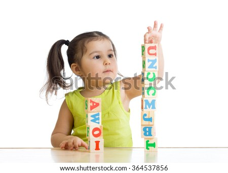 child little girl playing wooden toys  - stock photo