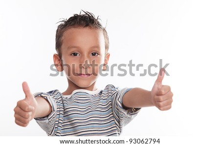 Child looking at the camera with thumbs up