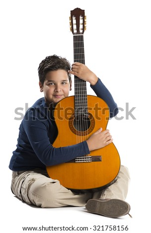 Child Loves His Guitar  - stock photo