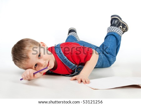 Child lying and drawing on white background