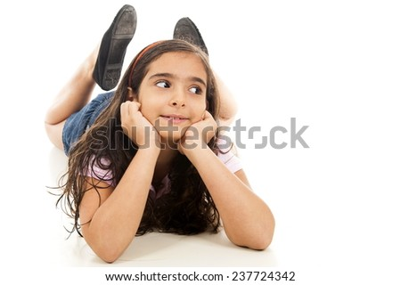 Child lying down and looking at side - stock photo