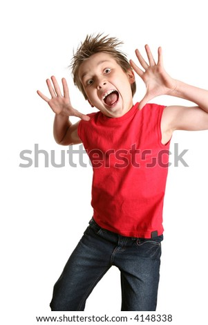 Child mid jump with a crazy happy face - stock photo