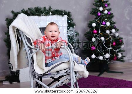 child near the Christmas tree - stock photo