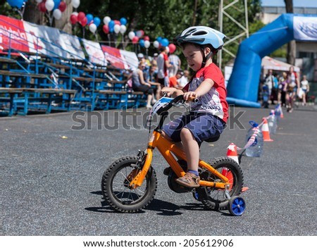 Child on a bicycle involved in the children's competitions - stock photo