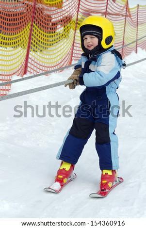 Child on a children ski lift.  - stock photo