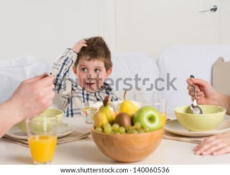 Child on breakfast - having fun - stock photo