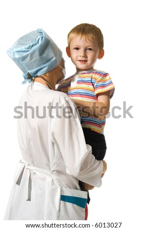 Child on hands at careful doctor - stock photo