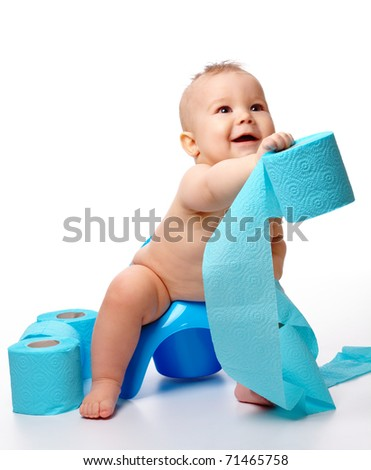 Child on potty play with toilet paper, isolated over white - stock photo