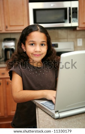 Child on the computer in the kitchen