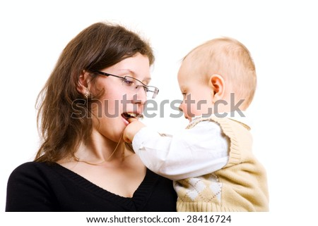 child on the hands of his mom - stock photo
