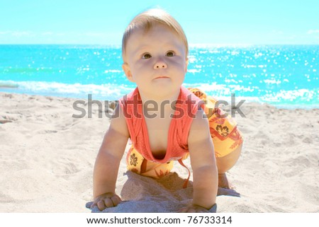 child on the shores of the sea