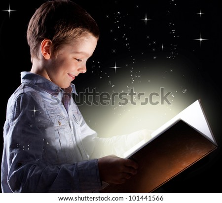 Child opened a magic book - stock photo
