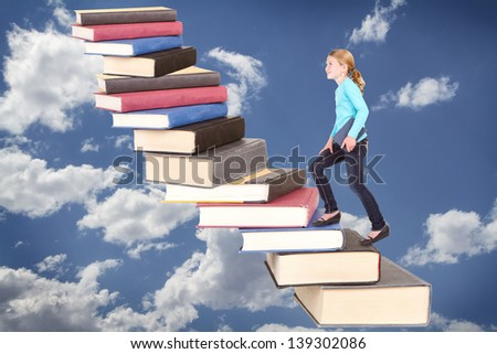 Child or girl climbing a staircase of books on cloudy sky background - stock photo