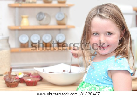child or kid cooking or baking cupcakes - stock photo