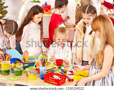 Child painting at art school. Education. - stock photo