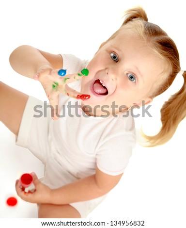 Child painting, sitting on the floor - stock photo