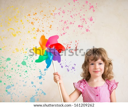 Child painting wall with multicolor palette. Renovation concept - stock photo