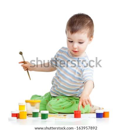 child painting with brush - stock photo