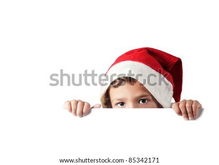 child peeking behind a white blank sign - stock photo