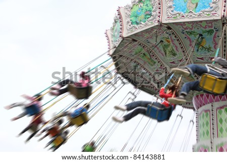child plaaying flying swing in park - stock photo